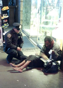 Officer Lawrence DePrimo bought new boots for a homeless man he encountered in Times Square. (Photo: Jennifer Foster)