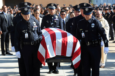 Pallbearers carry the casket of LAPD Officer Nicholas Lee following his funeral Mass at the Cathedral of Our Lady of the Angels in Los Angeles, CA March 13, 2014. Nicholas Lee was killed last Friday when the driver of a truck apparently lost control of his vehicle and struck Lee's police car, officials said.(Andy Holzman/Los Angeles Daily News)