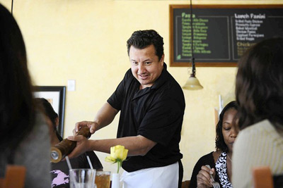 Oscar Morel, manager of Spumoni Italian Cafe & Pizzeria, prepares the Brentwood restaurant for the lunch hour. During the 405 closure the Canoga Park resident will be sleeping at a friend's house a few blocks from the cafe so he can make it to work. (Mariah Tauger, Los Angeles Times / June 28, 2011)