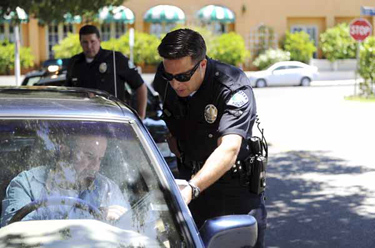 Los Angeles Police Officer Ray Navarro issues a citation to Osvaldo DeAguiar for talking on his cell phone while driving in Sherman Oaks Wednesday, April 27, 2011. (Hans Gutknecht/Staff Photographer)