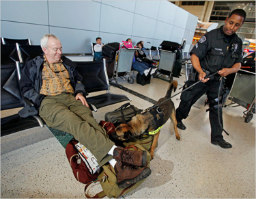 Reed Saxon/Associated PressA police officer and a sniffer dog on Thursday at Los Angeles International Airport after a demonstraton of the dogs.