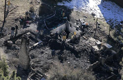 "After what LAPD Chief Charlie Beck called ""a bittersweet night,"" investigators Wednesday were in the process of identifying the human remains found in the charred cabin where fugitive ex-cop Christopher Dorner was believed to have been holed up after trading gunfire with officers, authorities said. ( Brian van der Brug / Los Angeles Times / February 13, 2013 )"