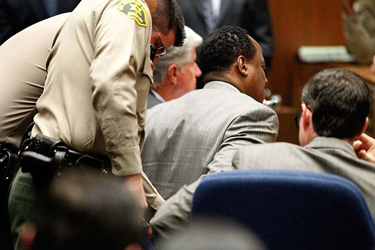Photo: Dr. Conrad Murray is handcuffed after verdict. Credit: Al Seib / Los Angeles Times