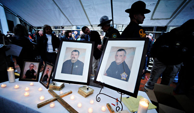 Jeff Gentner/Associated PressA vigil for four police officers from Buchanan County, Va., who were shot in March 2011. Two were killed, and two were wounded.