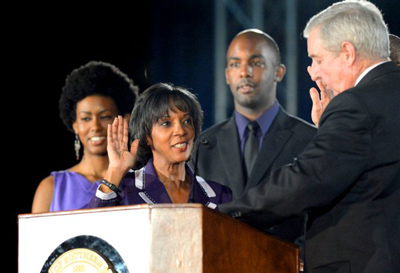 Los Angeles County District Attorney Jackie Lacey is sworn in by outgoing DA Steve Cooley on Monday, Dec. 3, 2012, at USC's Galen Center. (Andy Holzman/Daily News Staff Photographer)