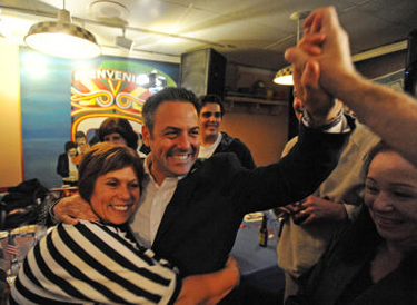 Los Angeles city council candidate Joe Buscaino gets a hug from his mother Rosa Buscaino as he greets his supporters during his campaign party at Puesta del Sol restaurant in San Pedro. Early mail-in ballots showed Buscaino in the lead. (Steve McCrank / Staff Photographer)