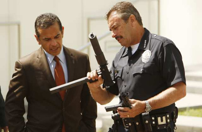 Los Angeles Police Chief Charlie Beck and Mayor Antonio Villaraigosa hold a news conference in May after an array of firearms were collected. Beck called L.A. the safest big city in America after the release of a midyear report on violent and property crime. Credit: Al Seib / Los Angeles Times