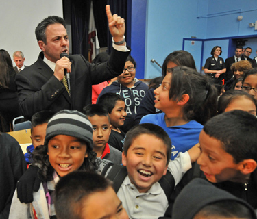 City councilman Joe Buscaino fires up residents at end of the Wilmington community meeting. (Robert Casillas / Staff Photographer)