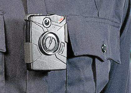 The Taser company's Axon body on-officer camera is seen clipped to an officer's uniform in this image from the company's web site. (Photo courtesy Taser)