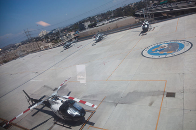 Helicopters parked on the tarmac on the top floor of a facility near the Men's Central Jail in downtown Los Angeles. Anyone who steps on the squadron's logo has to do 50 pushups. (Grant Slater/KPCC)