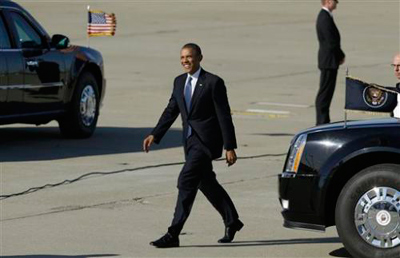 President Barack Obama arrives at Moffett Federal Airfield in Moffett Field, Calif., Thursday, June 6, 2013. (AP Photo/Jeff Chiu) (Jeff Chiu)