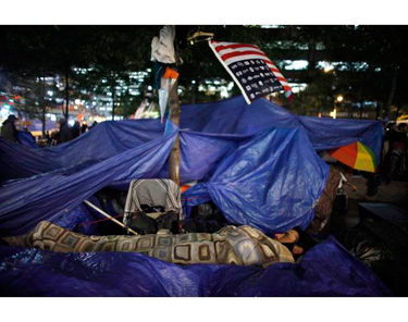 An Occupy Wall Street protester goes to sleep in Zuccotti Park, near Wall Street in New York.