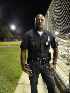 LAPD's Senior Lead Officer Craig Orange on a night patrol at Yosemite Park in October 2010. <i>(Ajay Singh)</i>