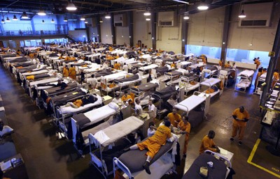 Several hundred inmates crowd the gymnasium at San Quentin prison in California. Photographer: Eric Risberg/AP