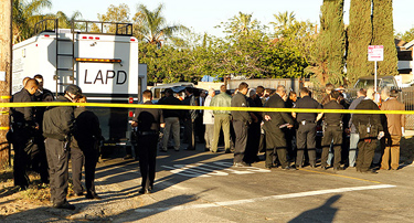LAPD officers at the command post in Symar. Credit: Al Seib / Los Angeles Times
