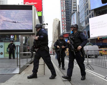 By Mary Altaffer, APNew York City police officers with Operation Hercules arrive at the Armed Forces recruitment center in New York's Times Square on May 2. New York City police have fielded 83,749 calls reporting suspicious packages since Sept. 11, 2001.