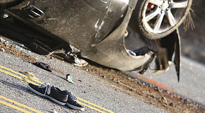A 17-year-old football player was killed and three other teens seriously injured in this crash after a night of partying. (Brian van der Brug / Los Angeles Times / May 8, 2012)