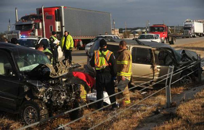 Emergency technicians at a crash in Abilene, Texas, on Thursday. Credit: Associated Press.