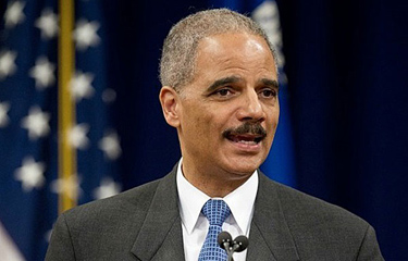 "Atty. Gen. Eric H. Holder Jr., shown in a file photo, said in a statement accompanying new crime statistics, ""I have made it a priority of this Department of Justice to protect the American public by aggressively fighting violent crime. (Paul J. Richards / AFP/Getty Images / September 19, 2011)"