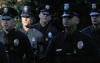 New recruits assemble for their graduation exercises at the Los Angeles Police Academy. The LAPD has seen a decline in qualified applicants over the last several months, and officials fear the department will remain understaffed if the decline continues. (Brian van der Brug, Los Angeles Times / November 27, 2013)