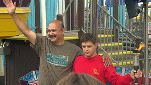 Det. Gus Martinez with his son Jason after setting the new Guinness World Record (KTLA-TV / June 1, 2012)