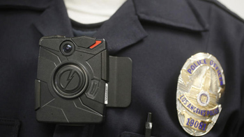A Los Angeles police officer wears a body camera. Customs and Border Protection says its agents will not wear cameras, in part because the cameras the agency tested failed to withstand agents' rugged working conditions. (Damian Dovarganes / Associated Press)