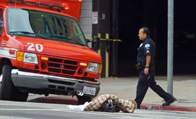 An LAPD officer works at the scene of a fatal auto-versus-pedestrian accident on Beverly Boulevard in June 2011. Los Angeles drivers have high rate of fatal pedestrian accidents, according to a University of Michigan study. (Ricardo DeAratanha / Los Angeles Times)