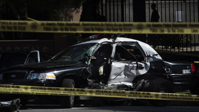 The wreck left the police car's radio unusable, forcing the other officer to use his personal cellphone to seek help. (Bob Chamberlin / Los Angeles Times)