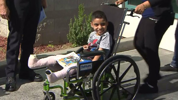 Giovanni and his mother attended a police news conference on Wednesday, June 17, 2015. (Credit: KTLA)
